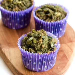 Image with three Pumpkin Seeds and Blueberries Keto Muffins.