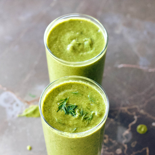 Two servings of Yummy Green Smoothie with Spinach and Avocado.
