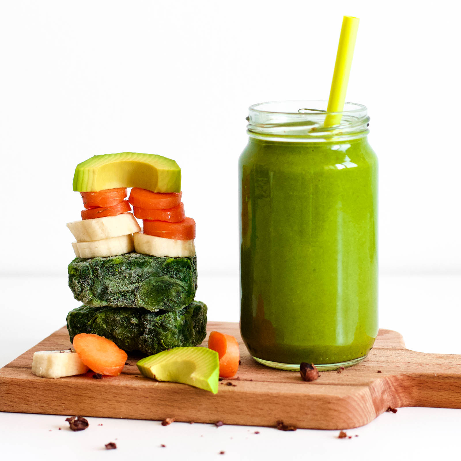 One serving of 5 Ingredients Simple Green Smoothie and vegetables stack on the side.