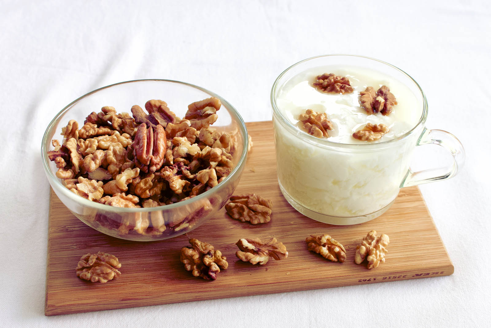 Big cup of Homemade Yogurt served with Walnuts and Pecans.