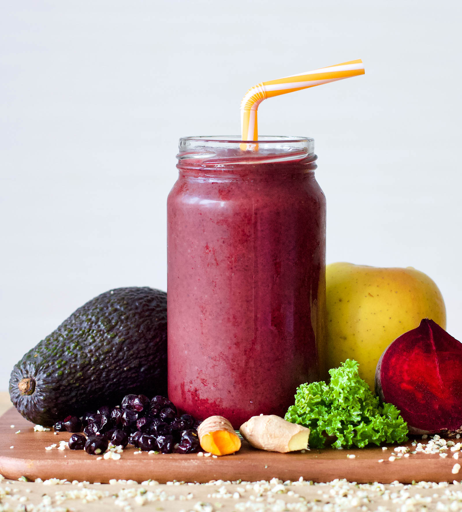 Berries and Red Beet Spicy Smoothie in a jar, fruits and vegetables around it.