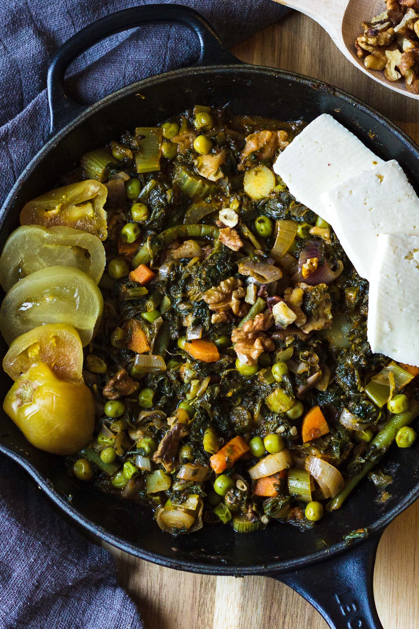 Skillet with cooked spinach and vegetables
